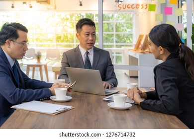 Business team have a meeting in a cafe