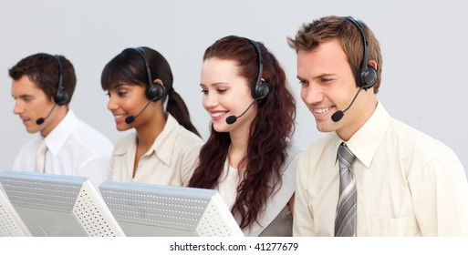 Business team with a headset on working in a call center