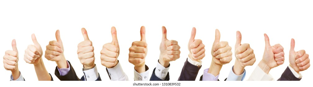 Business team hold thumbs up as success concept