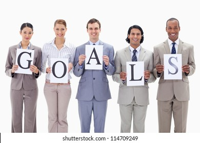 Business team holding the letters of GOALS against white background