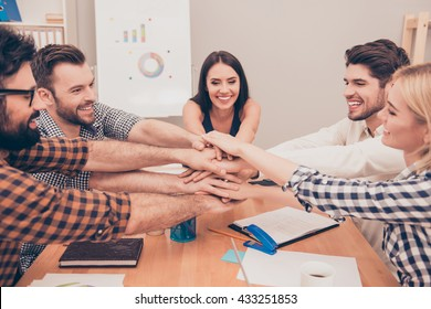 business team holding their hands on top of each other