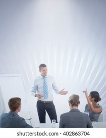 Business team interacting during brainstorming session against black glowing design