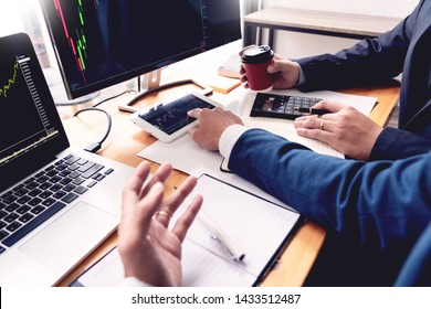 Business Team Investment Entrepreneur Trading discussing and analysis data the stock market charts and graphs negotiation and research budget, teamwork traders
