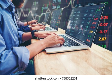 Business Team Investment Entrepreneur Trading working on Laptop Stock market exchange information and Trading graph