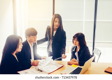 Business Team job. working with laptop in open space office. Meeting report in progress. Corporate Organization Meeting Concept