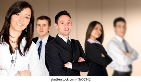 business team lead by a businesswoman in an office