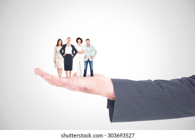 Business team looking at camera against white background with vignette