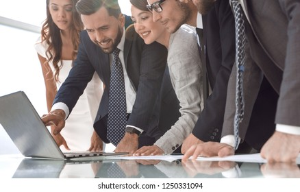 business team looking at the laptop screen