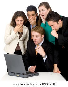 business team looking shocked and worried when looking at the laptop computer on the table