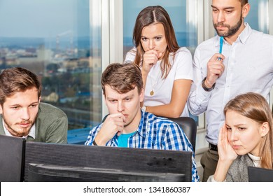business team manages critical situation due to software error causing loss. people group with desperate faces.