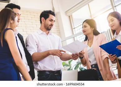 Business team meeting or brainstorming and discussing with financial data and analyzing report graph at office. Teamwork meeting and partnership conference working concept.