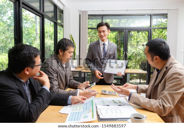 Business team meeting and discussing project plan. Businessmen discussing together in meeting room. Professional investor working with business project together.
