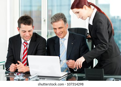 Business - team meeting in an office with laptop, the boss with his employees