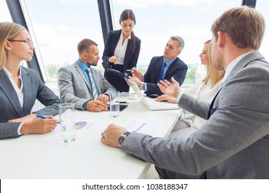Business team meeting. People in office working with laptop computer and financial reports in desk
