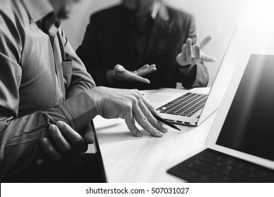 Business team meeting. Photo professional investor working new start up project. Finance task.Digital tablet docking keyboard laptop computer smart phone using, black white