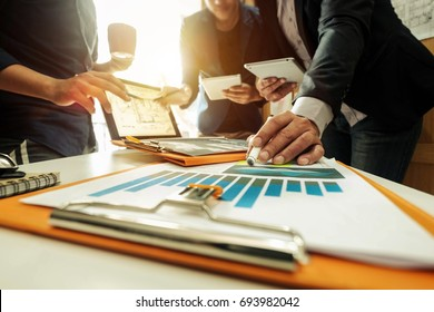Business team meeting. Photo professional investor working new start up project. Finance task.Digital tablet docking keyboard laptop computer smart phone in morning light