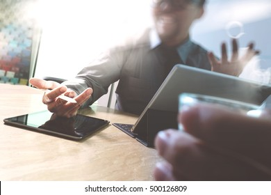 Business team meeting present. Happy professional investor working with new start up project. Digital tablet laptop computer design smart phone using, keyboard docking screen,sun flare