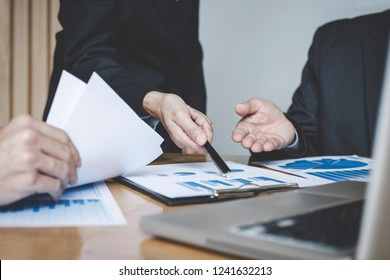 Business team meeting present, investor colleagues consultation and conference new strategy plan business and market growth on financial document graph report, Meeting and Talking.
