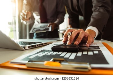 Business team meeting. professional investor working new start up project. Finance task. with smart phone and laptop and digital tablet computer  in morning light