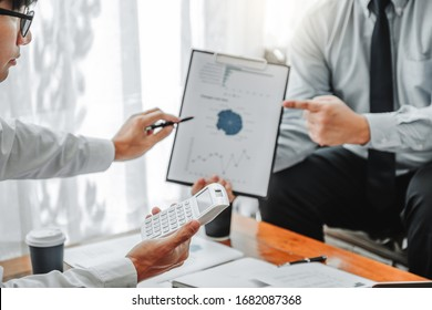 Business team meeting Strategy Planning with new startup project plan Finance and Economy Graph with laptop successful teamwork