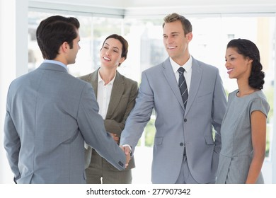 Business team meeting their partner in the office
