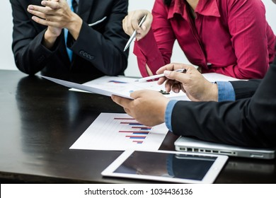 Business team meeting at working with financial reports and analyzing investment charts. Business concept.