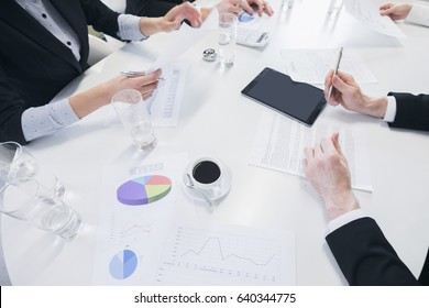 Business team at meeting working with financial reports