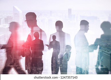 Business team members silhouettes working together and walking over morning cityscape background. Business lifestyle concept. Toned image double exposure