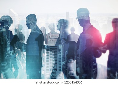 Business team members silhouettes working together and walking over foggy cityscape background. Business lifestyle concept. Toned image double exposure