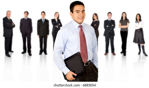 Business team in an office with a businessman leading
