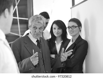 business team in the office in front of a board