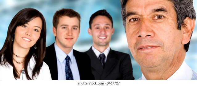 Business Team in an office led by a senior businessman