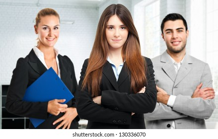 Business team in an office welcoming you