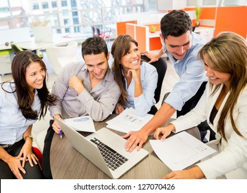 Business team at the office working on a laptop