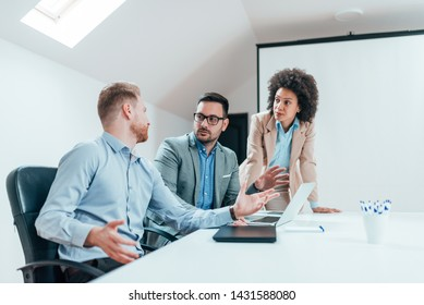 Business team on meeting in modern bright office.