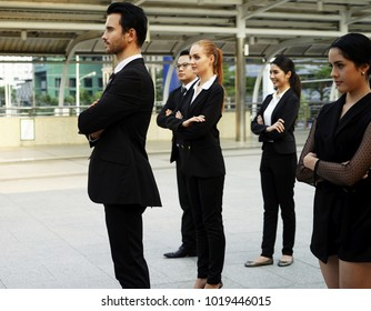 Business team outdoor,Confident business team of man and woman standing with crossed hands, team spirit concept, couple of success business people ready to act, business manager and employee ready.