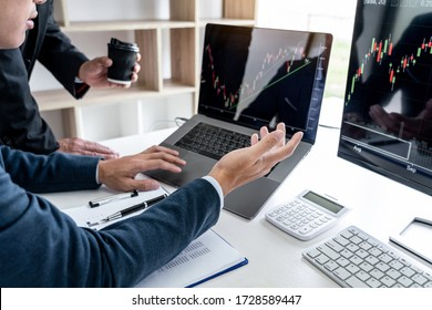 Business team partner working with computer, laptop, discussion and analyzing graph stock market trading with stock chart data planning, financial and investment concept.