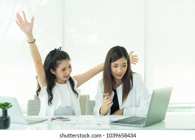 Business team people conversation, discussing current problems issues in office. Start up lady partners talking business plan ideas. young women working together. female coworkers reading report.