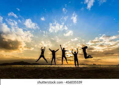 Business Team people jumping retreat together on the beach for happy weekend Family wellness life travel concept for celebrate of good success mlm freedom saving financial support, great friend day