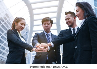 business team people smart standing and join hand or handshake in outdoor as teamwork concept