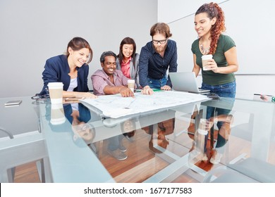 Business team planning a project in the office at a table