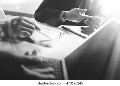 Business team present. black and white. professional investor working startup project. Finance manager meeting.Digital tablet laptop computer smart phone using, keyboard dock screen foreground