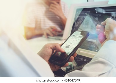 Business team present. Photo professional investor working with new startup project. Finance managers meeting.Digital tablet laptop computer design smart phone using. Sun flare effect