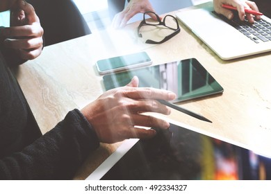 Business team present. Photo professional investor working with new startup project. Finance managers meeting.Digital tablet laptop computer design smart phone using, Sun flare effect