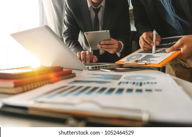 Business team present. professional investor working new start up project. Finance managers meeting.Digital tablet docking screen computer design smart phone using, in morning light