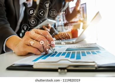 Business team present. professional investor working new start up project. Finance managers meeting.Digital tablet laptop computer design smart phone using, sun light