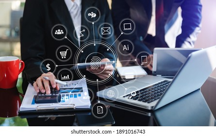 Business team present. professional investor working new start up project. .Digital tablet laptop computer Finance managers meeting with digital marketing media  in virtual icon in morning light