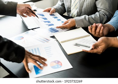 Business team presentation meeting Asian Men Finance Executive discusses meetings to plan work, investment projects, and trading strategy for trading partners. Finance and Accounting