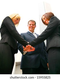business team putting hand together to celebrate success they have achieved