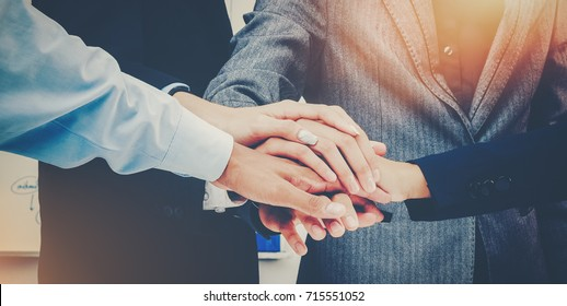 Business Team putting their hands together Celebration unity and teamwork group of success concept Symbol of cooperation